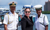 U.S. Charge d'Affaires with RBF Commodore, and RBDF Marine at ceremony.